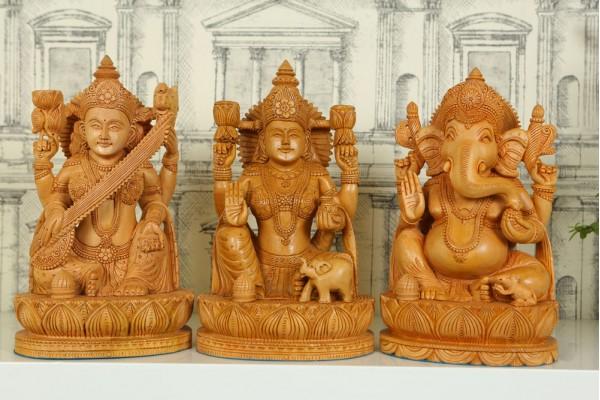 Wood carved Statue of Ganesh Lakshmi and Saraswati
