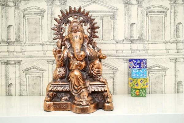 Aluminum Ganesha idol in sitting posture